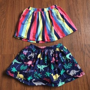 Lot of 2 size 3T Carter's skirts dino and stripe